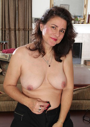 Mature brunette Gianna Jones is playing with her hard horny niplles