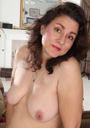 Old woman Gianna Jones is taking off her clothes and plays with puss