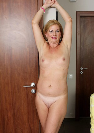 Awesome mature chick Laura Oswald shows her sweet small boobies