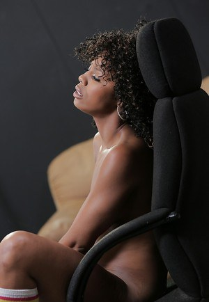 Curly brunette ebony Misty Stone gets naked and plays with her body