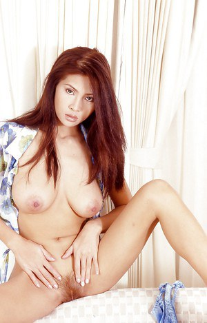 Slender Asian MILF with hairy hole is playing with her tasty holes