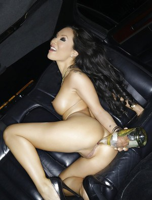 Glamorous Asian Asa Akira is posing naked on the backseat in limo