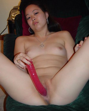 Teenager from Asia is filling her vagina with this big sextoy