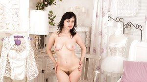 Dark-haired brunette Nikita is playing with her pussy on the camera