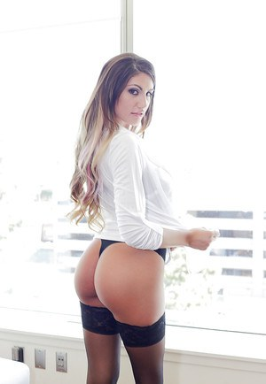 Busty tanned chick August Ames shows off her juicy nice booty