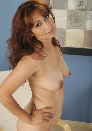 Busty mommy Estella Eves is posing naked and playing very hot