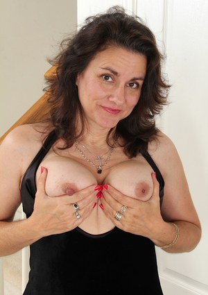 Cute mature Gianna Jones plays with her sexy-looking hairy pussy