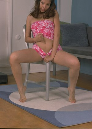 Beautiful model Niha is posing on her chair and playing with puss