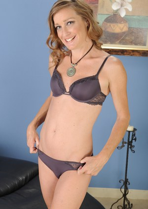 Milf Cindi Thompson shows her small boobies and long skinny legs