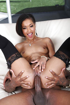 Leggy ebony in stockings is having an awesome black sex with BBC