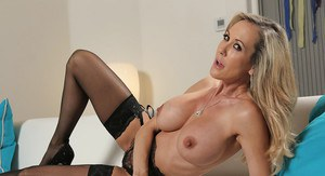 Milf blonde Brandi Love is posing and playing with her hot snatch