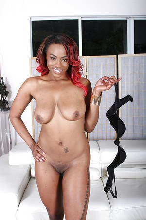 Redhead ebony Tori Taylor is stretching her black hole with fingers