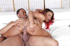 Redhead ebony Tori Taylor is banging in doggy pose and getting cumshot
