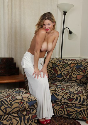 Cute busty Avery Johannson takes off her white dress to show up pussy