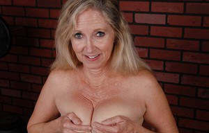 Sexy granny Annabelle is demonstrating her nice saggy boobies