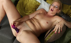 Spicy chick with nice face Laura Oswald is sucking her dildo