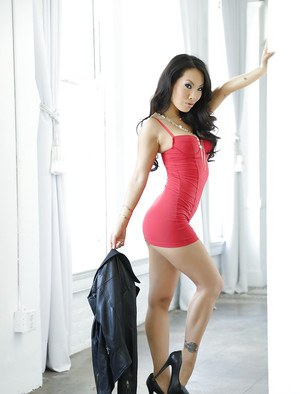 Asian mommy Asa Akira is posing on her high heels insanely sexy