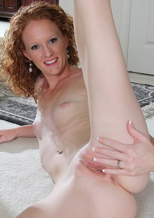 Sexy woman Ande is playing with her nice shaved pussy and small tits