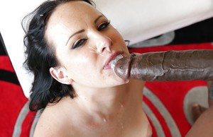 Big black fucker is drilling slutty model Katie St. Ives in her mouth
