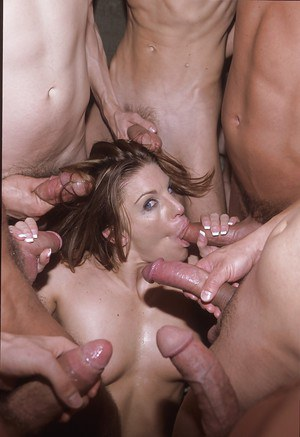 Tanned mature Jackie Moore fucks with a gang of horny hard dicks