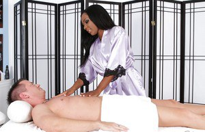 Sexy brunette Persia Black is giving a massage and a blowjob