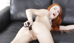 Redhead playboy babe Eva Berger bangs her juicy anal hole with dildo