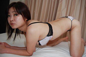 Milf Akiko Nemoto is playing with her naked body in close-up
