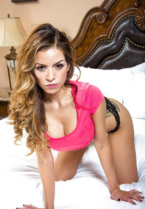 Latina Yurizan Beltran is posing on the bed with spread legs