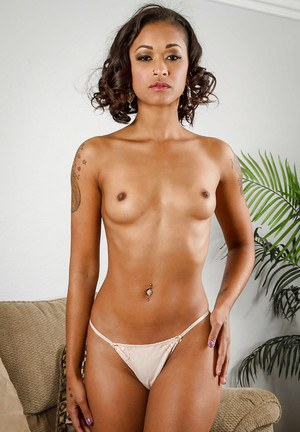 Ebony Skin Diamond is lifting up her dress to show us her black booty