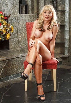 Cougar blonde Sasha Sean undresses so hot that you will get a boner