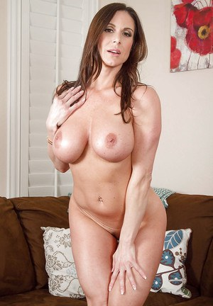 Big-tit brunette Kendra Lust is undressing and stroking her clit