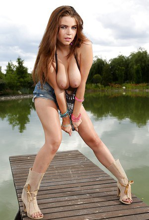 Teen with big boobies Marina Visconti is posing naked outdoors