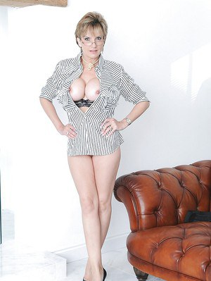 Tall mature slut Lady Sonia is sitting with naked boobies on sofa
