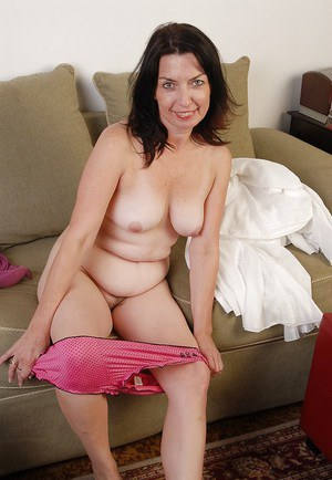 Mature Scarlette touches her nasty but cute hairy snatch on cam