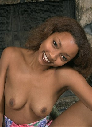 Amateur Ebony Isis shows her natural boobies and shaved pussy