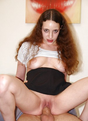 Curly-haired brunette swallows sperm right after hard day working