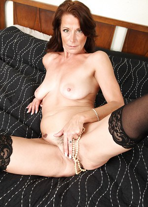 Sweet beauty Mimi Moore is playing with toys and her hairy pussy