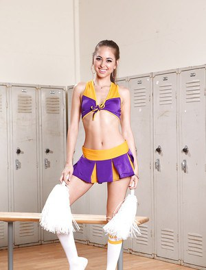 Cheerleader Riley Reid is posing like a stripper and touching her puss