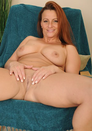 Cute milf Gia Sophia takes her jeans off and plays with hard nipples