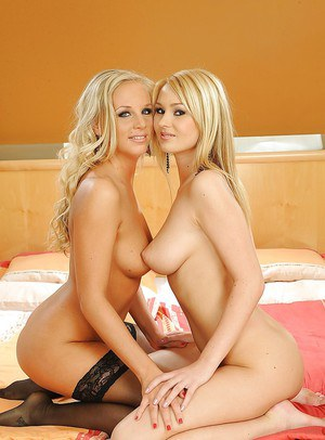 Long-legged blondes Barbie White and Antonya are posing pretty sexy