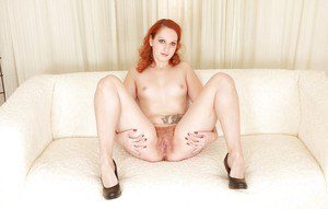 Redhead babe Susian is showing off her spicy hairy pussy in close-up