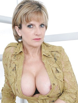 Mature blonde Lady Sonia poses in her brown nylons with naked tits