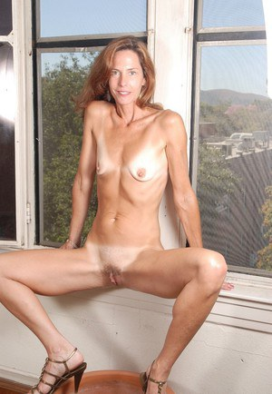 Mature redhead Sherry shows off her tight hairy holes on the cam
