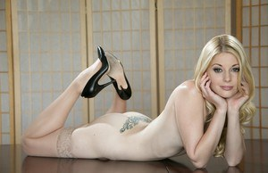 Amazing-looking babe blonde Charlotte Stokely shows off her good ass