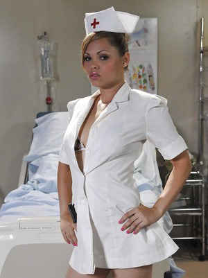 Nurse Shay Jordan takes off her sexy uniform and plays with pussy