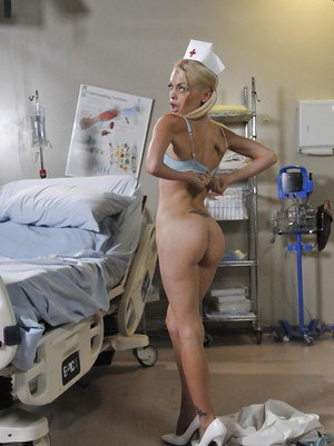 Young slick nurse Jesse Jane is touching her sweet juicy booty