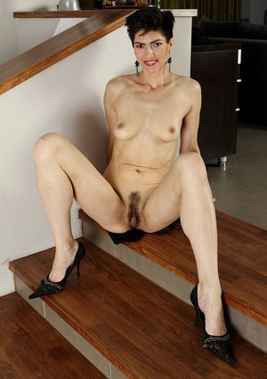 Skinny Asian Halle B. takes off her evening dress to present her tits