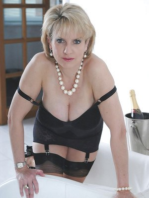 Fetish mature Lady Sonia is posing with her sexy-looking high heels