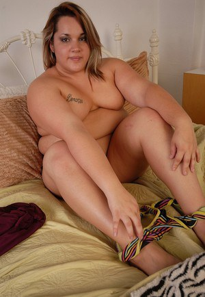Fatty chick with tattoos is undressing hot and playing with nipples