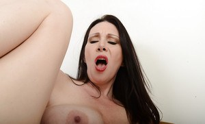Mature brunette Ray Veness is sucking this nice-looking purple dildo